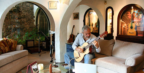 Renato Bellucci, practicing guitar