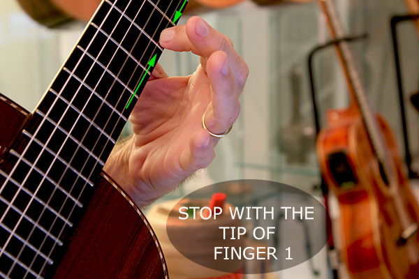 Stop the note with the tip of the finger