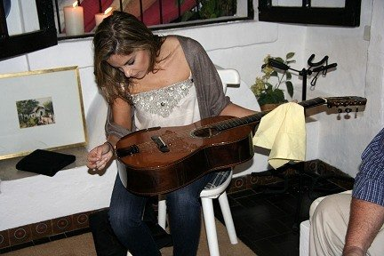 Guitarist Ana Vidovic, looking at the violin tie system used on the guitars