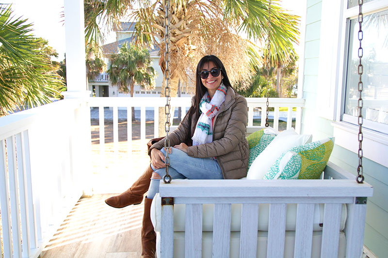My Beautiful wife Belén sitting in Steve's Porch. Seagulls and Pelicans were flying all around...